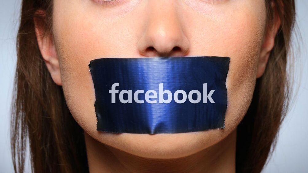 Рот, заклеенный логотипом Facebook